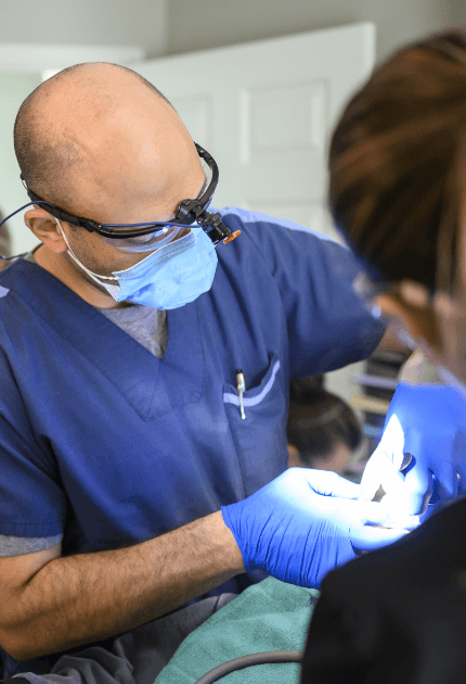 Dr. Jacobs placing dental implant post